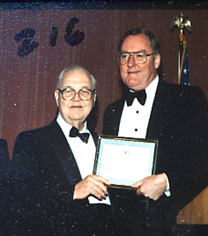 Mike Howlett and Gov. Thompson with Award